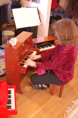 Paula with toy pianos